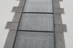 Glass stormg Glazing Church and historial building conervation heritage glass protective metal frame in Northern Ireland UK and