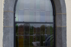 Storm Glazing Curved headed window frames aluminium protective water proof stained glass protection for church glass in northern ireland storm glazing